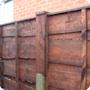 Waneylap fence panels with matching fence post extensions.